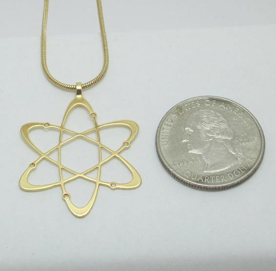 Carbon atom gold coin