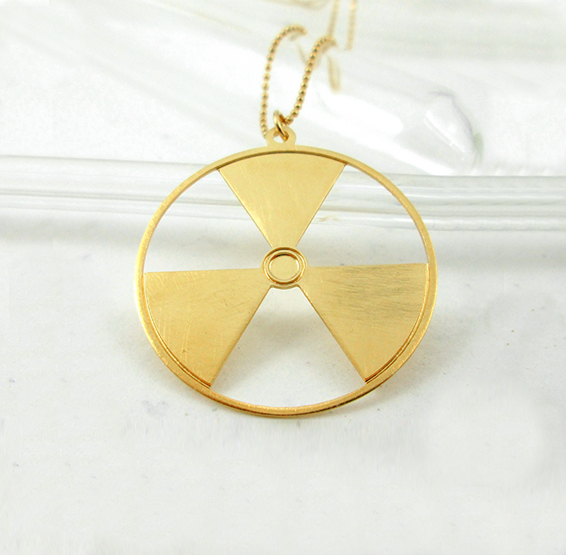 Radiation symbol gold necklace by Delftia science jewelry