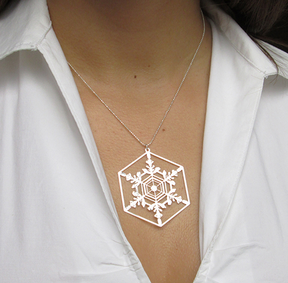 Snowflake crystal silver necklace on a model by Delftia