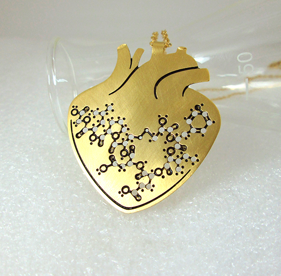 Oxytocin hormone molecule in anatomical gold heart by Delftia science jewelry