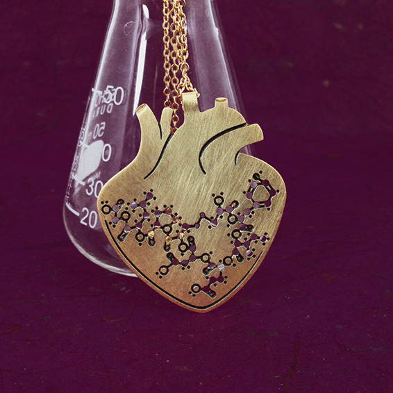Oxytocin molecule in anatomical heart gold by Delftia science jewelry