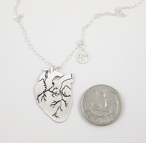 Anatomical silver heart with blood type charm