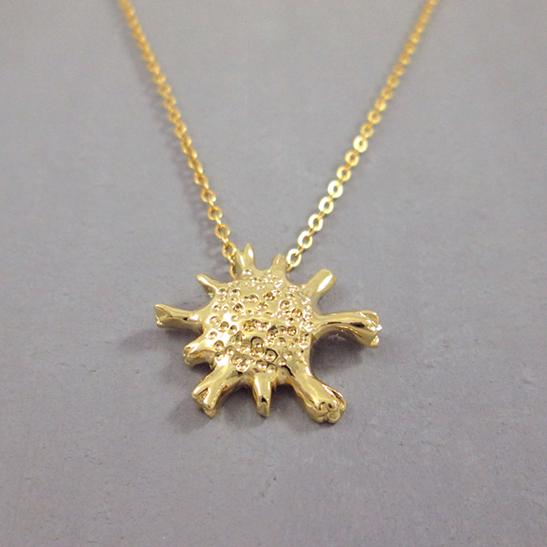 calcarina gold foraminifera necklace by Delftia science jewelry