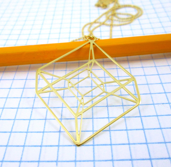 Tesseract necklace in gold by Delftia Science Jewelry