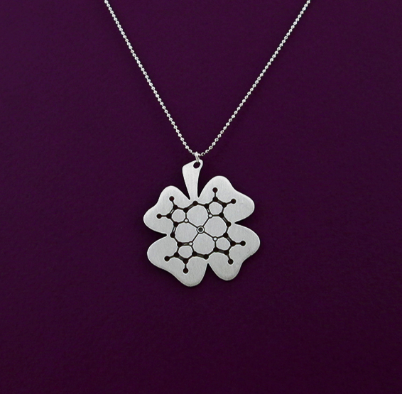 Chlorophyll molecule in a clover necklace in silver by Delftia Science Jewelry