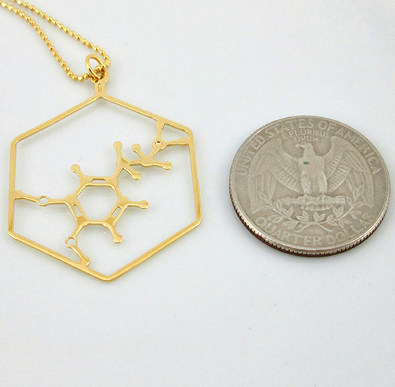 Dopamine molecule in gold, from delftia jewlery