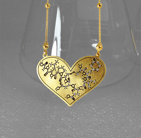 Oxytocin molecule in heart shape gold necklace by Delftia science jewelry