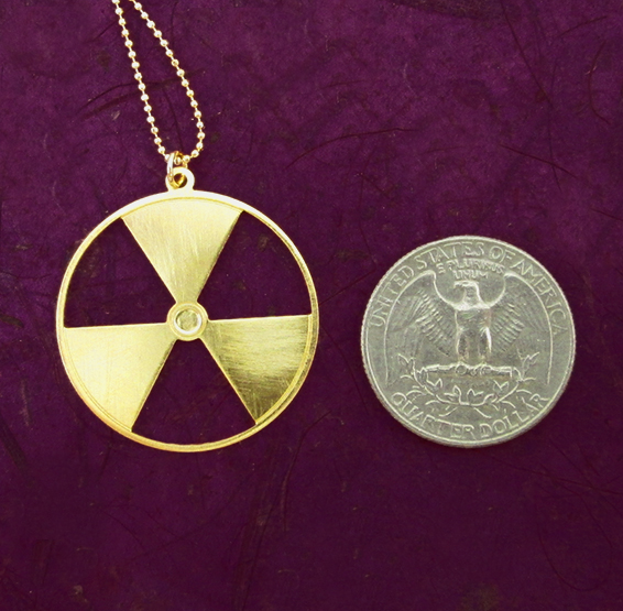 Radiation symbol gold coin