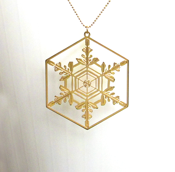 microscopic depiction of a snowflake crystal gold necklace by Delftia science jewelry