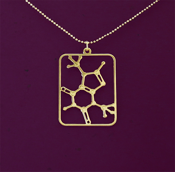 Theobromine molecule necklace in gold by Delftia Science Jewelry
