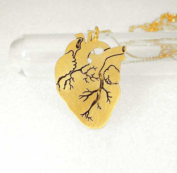 Anatomical heart in gold