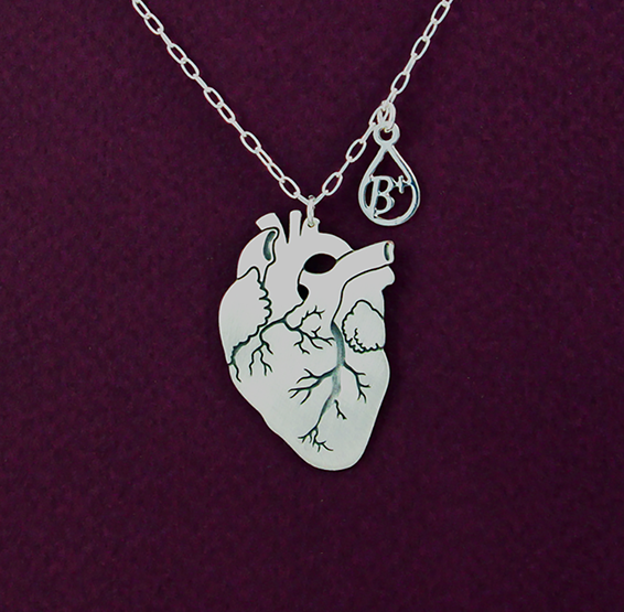 Anatomical heart necklace with silver blood type charm by Delftia science jewelry
