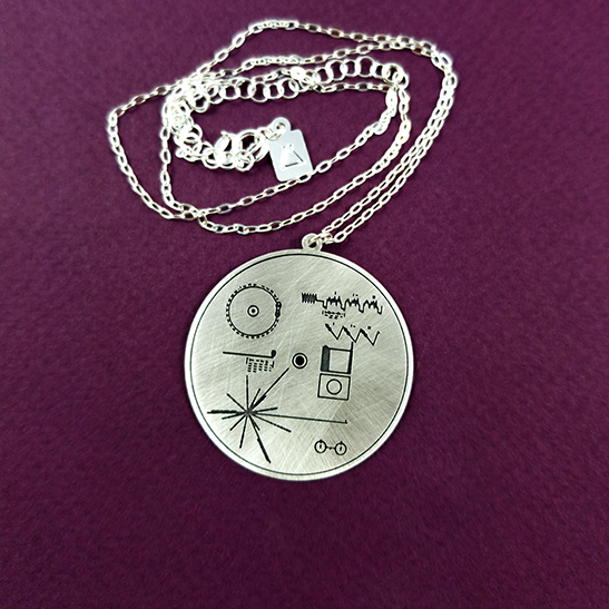 Voyager record pendant by Delftia Science Jewelry