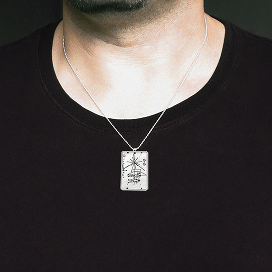 pioneer plaque necklace on man by Delftia Science Jewelry