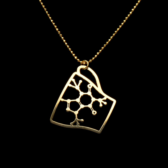 Caffeine molecule in a coffee cup necklace in gold by Delftia Science Jewelry